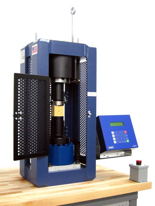 Hydraulic Testing Machine equipped with ADMET's MegaForce testing a cement cube