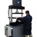 Inverted 600kN compression system for testing medical devices