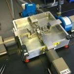 Planar biaxial machine with fluid bath
